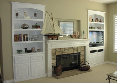 White entertainment center with bookcases