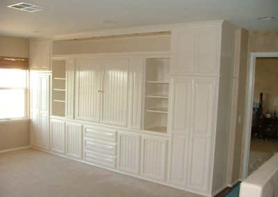 White entertainment center with beadboard doors