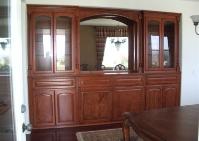 Built in cabinetry with mirrored backing