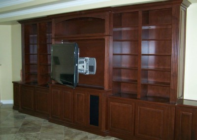 TV mounted in custom entertainment center cabinet