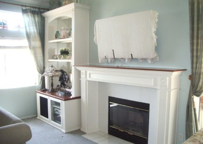 White built in shelves and fireplace mantel
