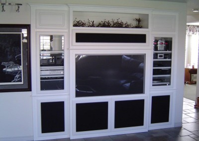 Get a white wall unit with a place for all of your media components.