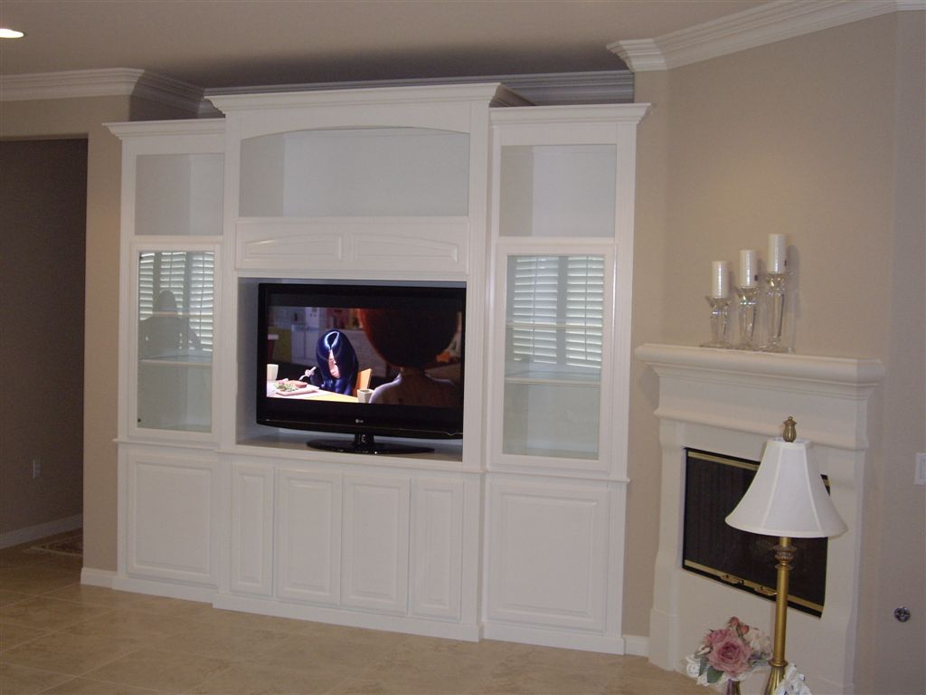 Custom White Entertainment Center With Glass Doors