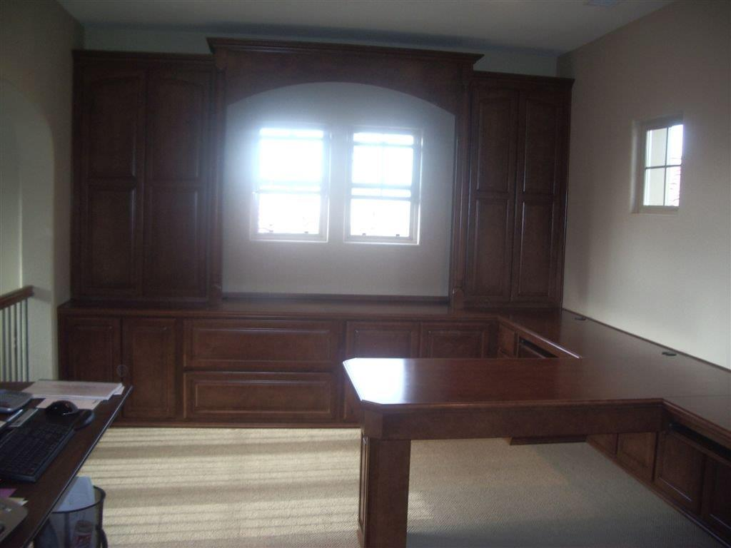 Home Office Cabinets Built Around Window
