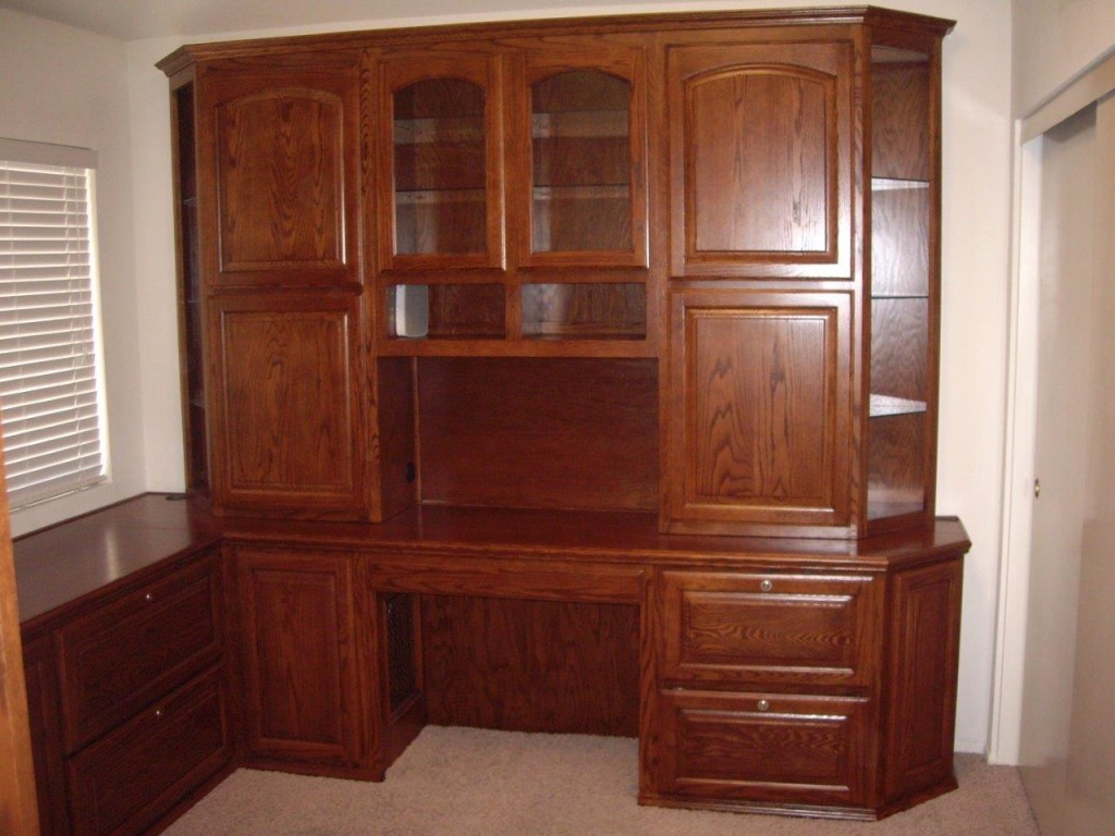 oak home office cabinets with arched doors