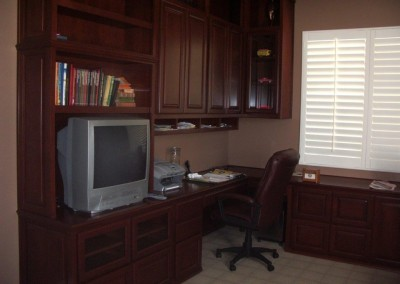 Home office with file cabinets and upper storage.