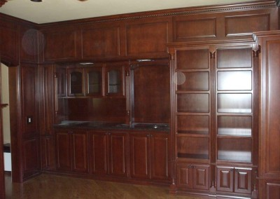 Floor to ceiling home office cabinets with dentil crown molding