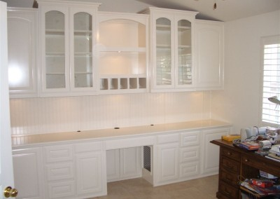 White home office with beadboard accent