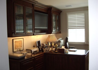 Built in partner's desk in home office. Cabinets for sale in Southern California