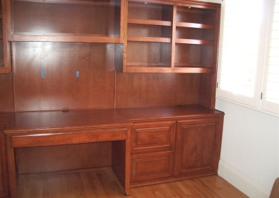 Built in lighting in home office cabinets