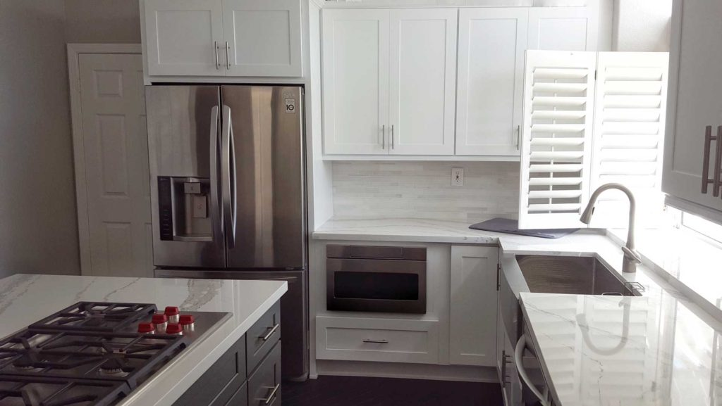 Grey and white shaker kitchen cabinets