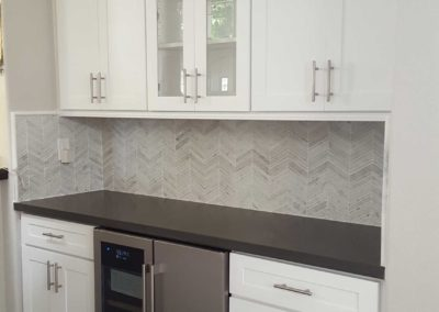 White shaker kitchen cabinets with glass insert